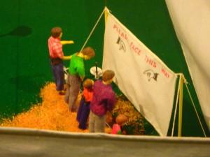 Mini-circus goers taking a whizz.